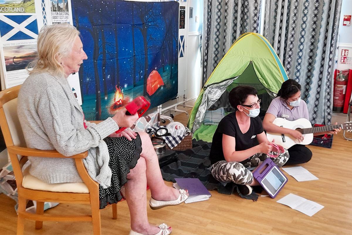 Lukestone Care Home residents enjoy a fireside singalong